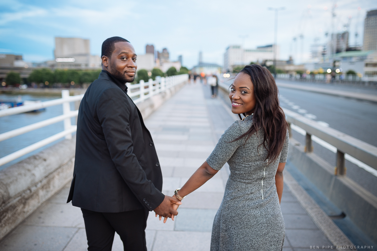 Pat & Ben's engagement shoot on Waterloo Bridge overlooking River Thames by London Wedding Photographer Ben Pipe