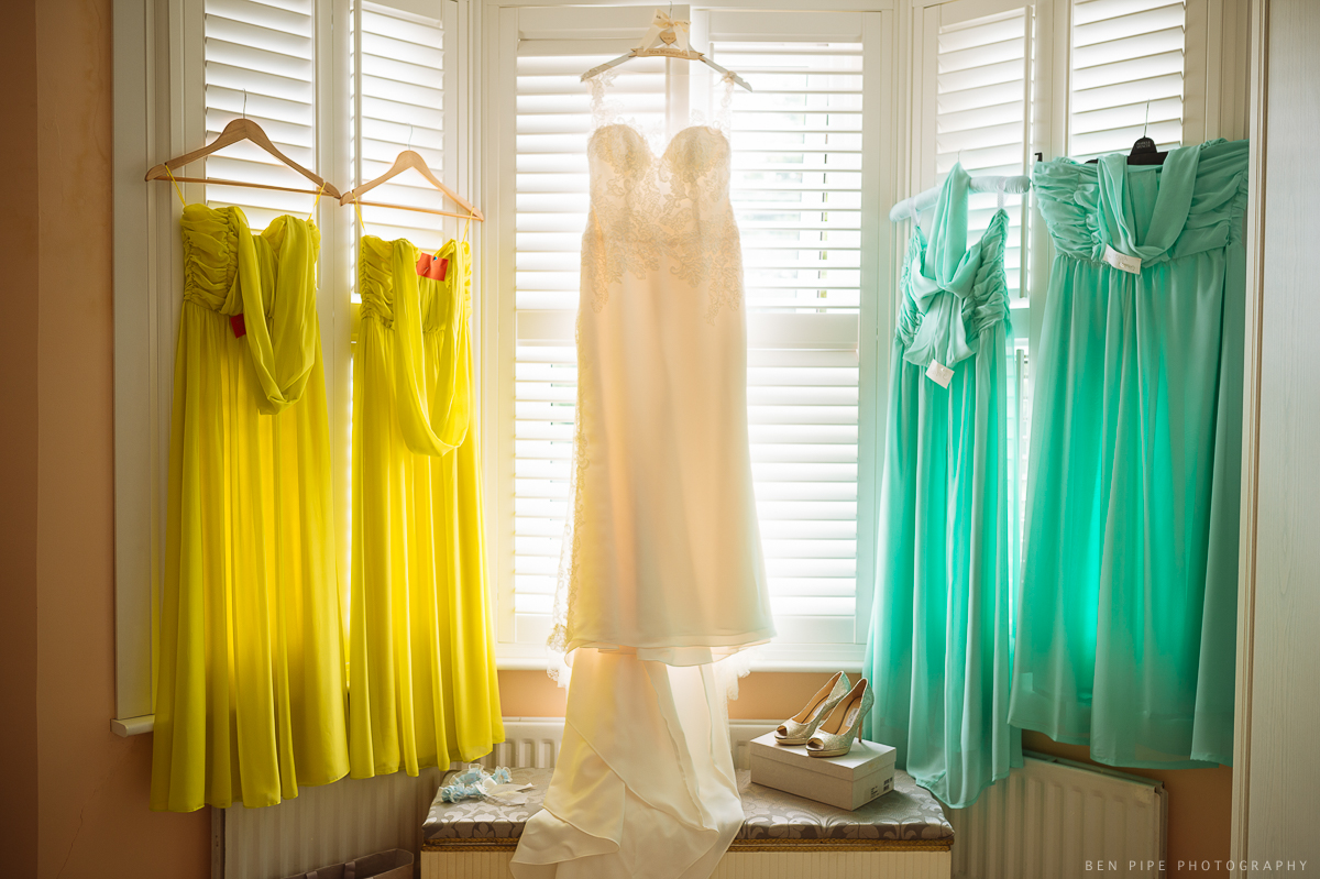 wedding preparations brides dresses hanging photo london