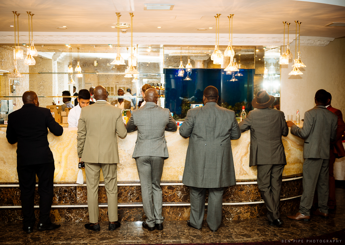 men waiting at bar suits marriott hotel