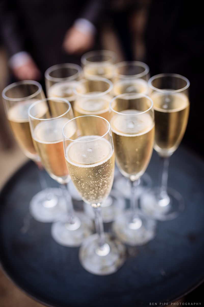 Champagne at Ruth & Arron's Wedding at Trinity Buoy Wharf, London by Ben Pipe Wedding Photography