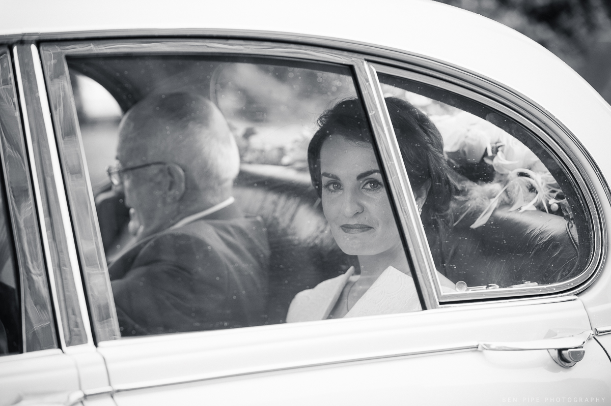 Bride and father in car before wedding ceremony Ireland