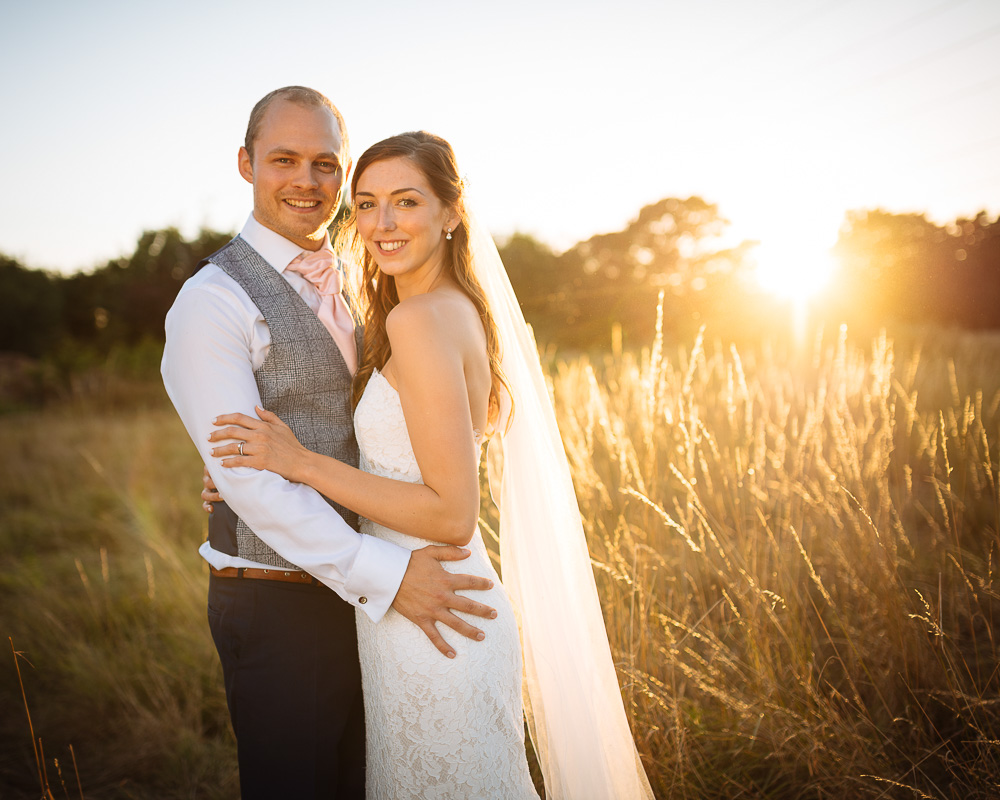 Couple portrait at sunset at Megan and Sean's Wedding at Rivervale Barn, Yateley by Ben Pipe Wedding Photography on 31st July 2018